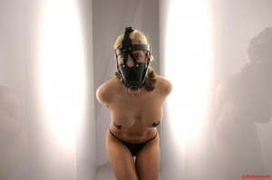 fetish slut in leather mask and electric tape on her nipples