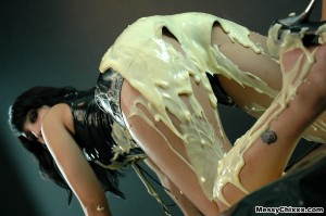 splosh and wam porn. girl in tight leather shorts covers herself in custard