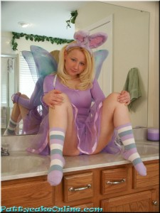costume bunny fairy girl gets naked. she is cute and has big tits